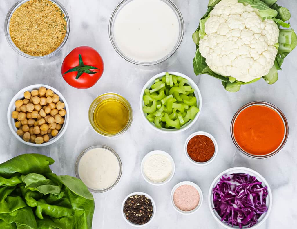 Salad ingredients laid out in circular bowls.