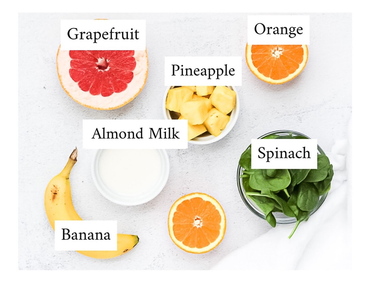 Labeled ingredients including grapefruit, orange, pineapple, almond milk, spinach, and banana.