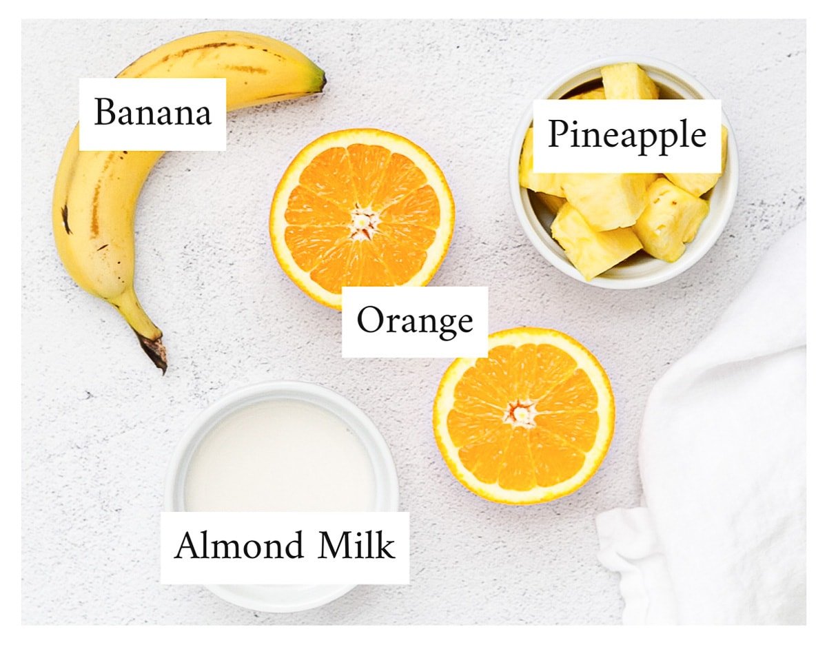A labeled picture of banana, pineapple, orange, and almond milk.